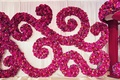 indian wedding, fuchsia and magenta flowers arrangement in scroll pattern