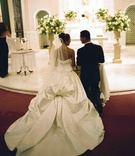 Couple in Catholic church for ceremony