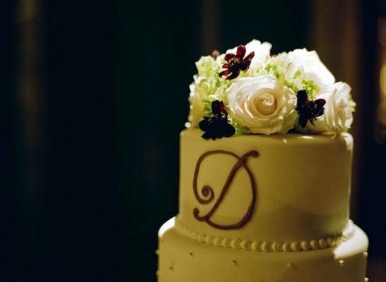 Round white wedding cake with monogram