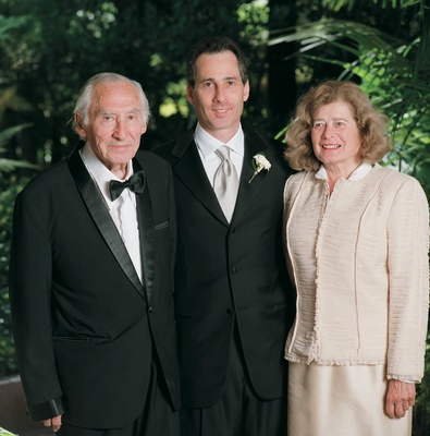 Wedding photo of groom with father and mother