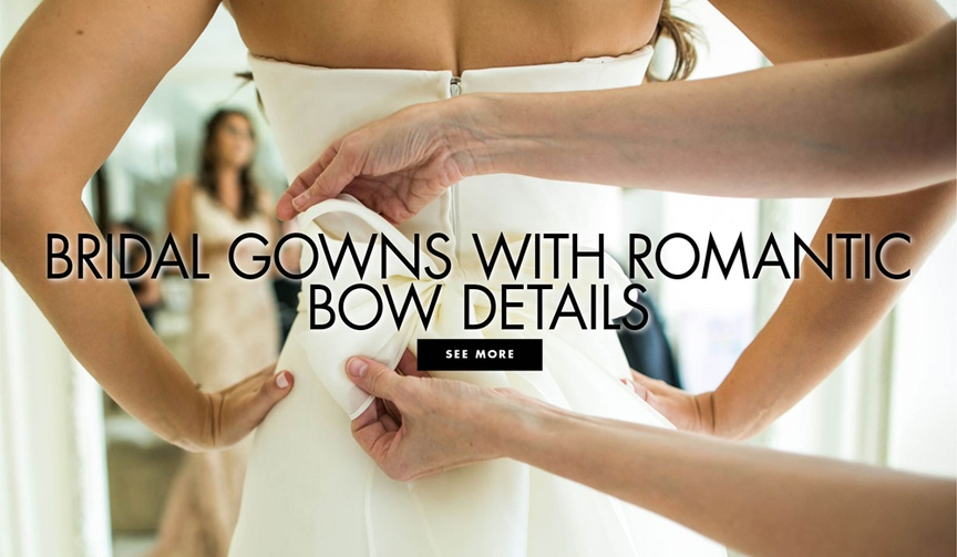 View beautiful bridal gowns with romantic bow details.