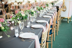 grey linens, gold chiavari chairs, blush napkins, row of small centerpieces, head table
