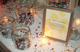 Wedding candy station with sweet shop sign
