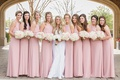 bride in romona keveza wedding dress with brocade applique, bridesmaids in blush jenny yoo dresses