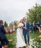 Montreal Canadiens Brian Flynn with wife in Isoude, aisle of white petals, outdoor ceremony