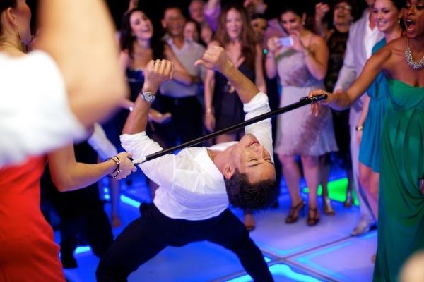 Illuminated dance floor and Extra host at reception
