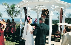 Couple in front of altar on oceanfront bluff