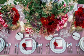 pink table linens white china red and dark purple flower arrangement rose rustic romantic