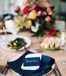 navy name card napkin place setting pink linen colorful arrangement Ukrainian wedding writing kiev