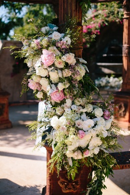 rustic dome column with ivory roses, white orchids, and blush peonies