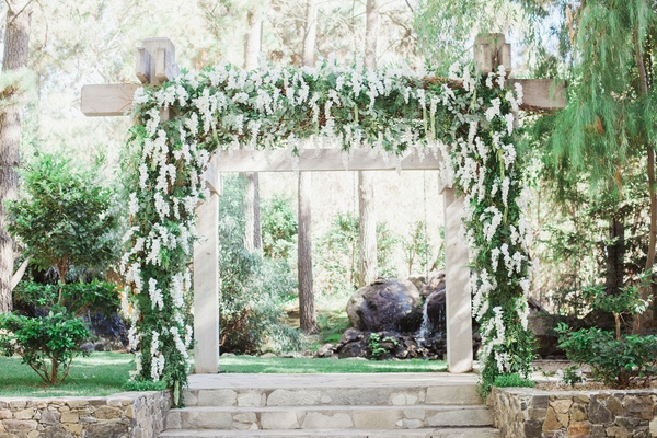 calamigos ranch wedding, wooden ceremony arch with wisteria greenery