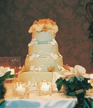 Four layer wedding cake with ivory and orange flowers