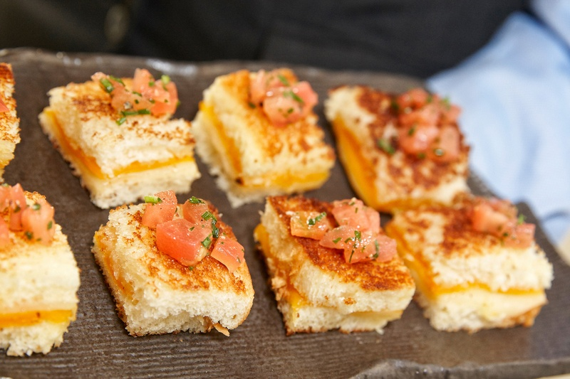 miniature grilled cheese sandwiches with diced tomato served at the waldorf astoria chicago