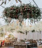 wedding reception tent wedding flower chandelier edison lightbulb vineyard chairs rustic decor