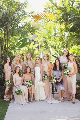bride in j. mendel wedding dress, bridesmaids in mismatched shades of blush and nude dresses