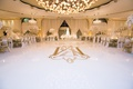 wedding reception white dance floor with custom gold monogram