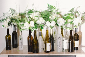 Wedding reception with ivory roses, hydrangeas, peonies, greenery in Robert Mondavi and Chopin vodka