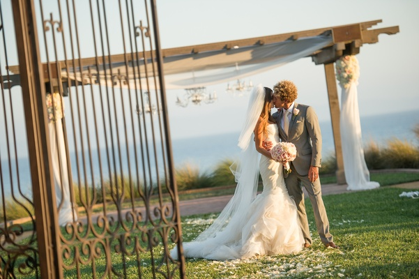 Bride and groom kiss at Terranea resort ceremony