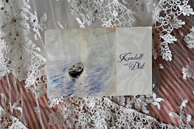 The inside of a wedding invitation bears the reproduction of a painting