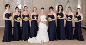 Bridesmaids in floor-length dresses holding nosegays