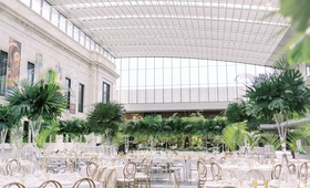 wedding reception cleveland museum of art tall ceiling glass skylight tropical centerpiece monstera
