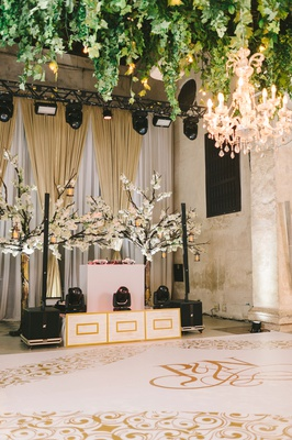 colombia wedding reception greenery chandelier ceiling installation white gold dj booth dance floor