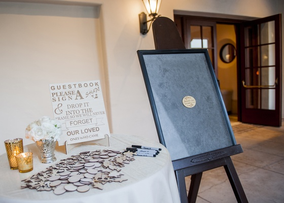 guest book of wooden chips to slide into frame, guests write message on wooden chips