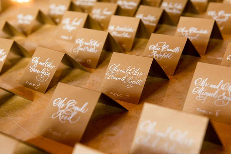 Brown kraft paper escort cards with silver calligraphy