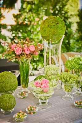 Grass-covered spheres and pink garden roses