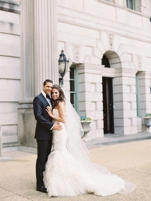 Wedding in Washington, DC wedding planner bride and handsome groom in tuxedo mermaid dress Carine's