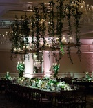 wedding reception dark decor green white flower greenery hanging centerpiece vines candles