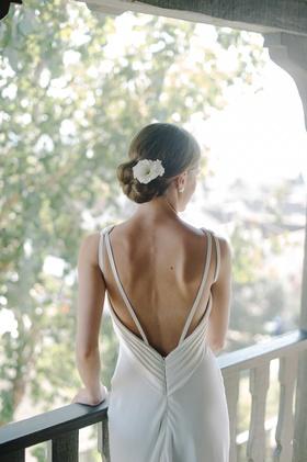 bridal gown low back straps suzanne neville hair flower beach wedding california