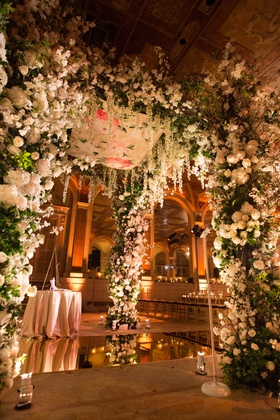 Mirror floor with flower chuppah with mirror floor and white flowers greenery the plaza hotel