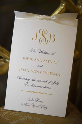 Wedding ceremony program card with ivory ribbon