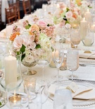 White wedding table with silver accents and pink flowers