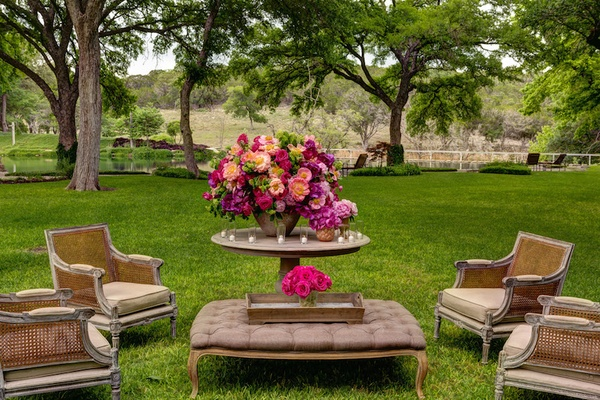 Outdoor wedding lounge area with aged wood chairs and furniture