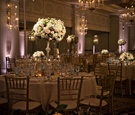 Pink purple uplighting ballroom Casa Del Mar hotel Santa Monica wedding tall flower arrangements