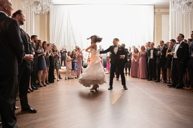 bride in essence of australia wedding dress, groom in bonobos tux, twirl on dance floor