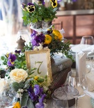 garden inspired arrangement purple yellow flowers new york city bridal shower wedding vintange