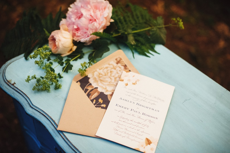 Wedding invitation with flowers and taupe envelope with peony graphic on liner