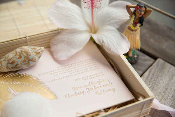 Lehr and Black destination wedding invitation in box with shell gold lettering feather hibiscus hula