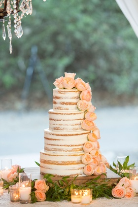 Semi naked four layer round tier wedding cake with fresh flower garden rose pink and green vines