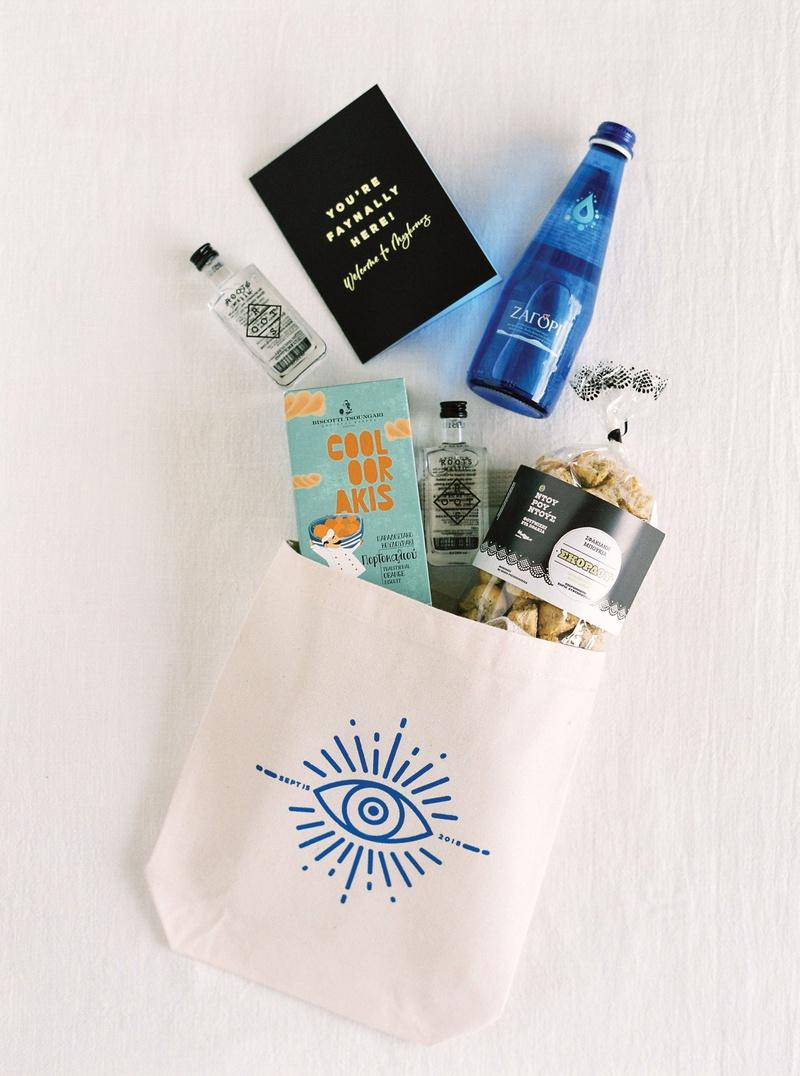mykonos wedding welcome bag evil eye tote greek water alcohol snacks and cookies