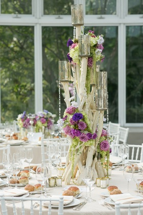 Wooden centerpiece with purple flowers, crystals, and mercury glass