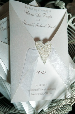 White ceremony program with beaded heart