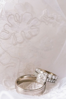 custom engagement ring with bride and groom's wedding bands