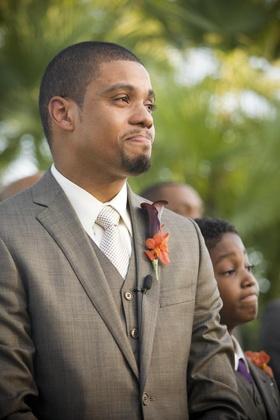 Look of groom as bride walks down the aisle