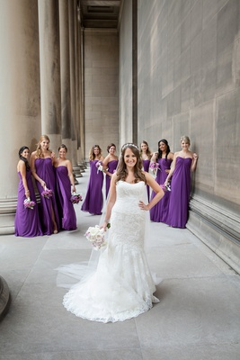 Bride in front of bridesmaids in purple gowns