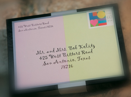Purple and green invitations in clear box