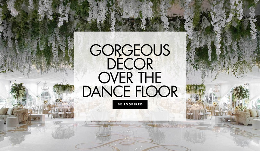 See beautiful floral and light arrangements arranged over the dance floor at elegant wedding recepti
